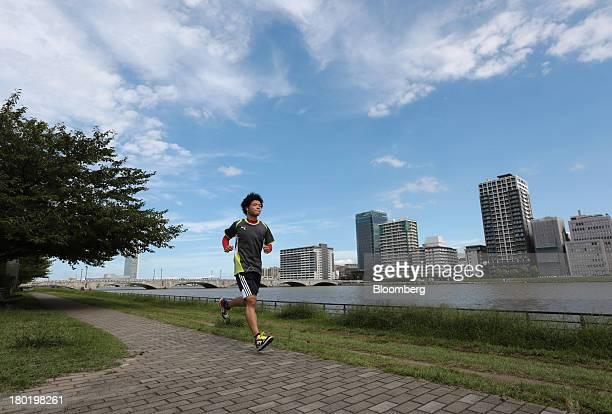 A man runs along the bank of the Shinano river in Niigata City Niigata Prefecture Japan on Friday Sept 6 2013 Niigata Governor Hirohiko Izumidas...
