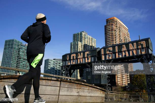 A man runs along the waterfront on November 14 2018 in the Long Island City neighborhood of the Queens borough of New York City Amazon announced on...