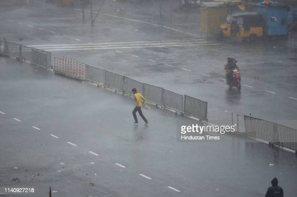 A man runs for shelter as cyclone Fani hits the coast on May 3 2019 in Puri India Cyclone Fani on Friday lashed Odisha triggering heavy rainfall...
