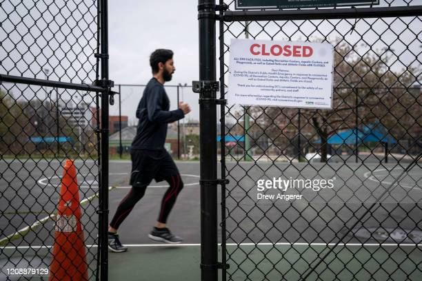 A man runs inside a closed DC Department of Parks and Recreation basketball court on April 1 2020 in Washington DC As of April 1 the entire national...