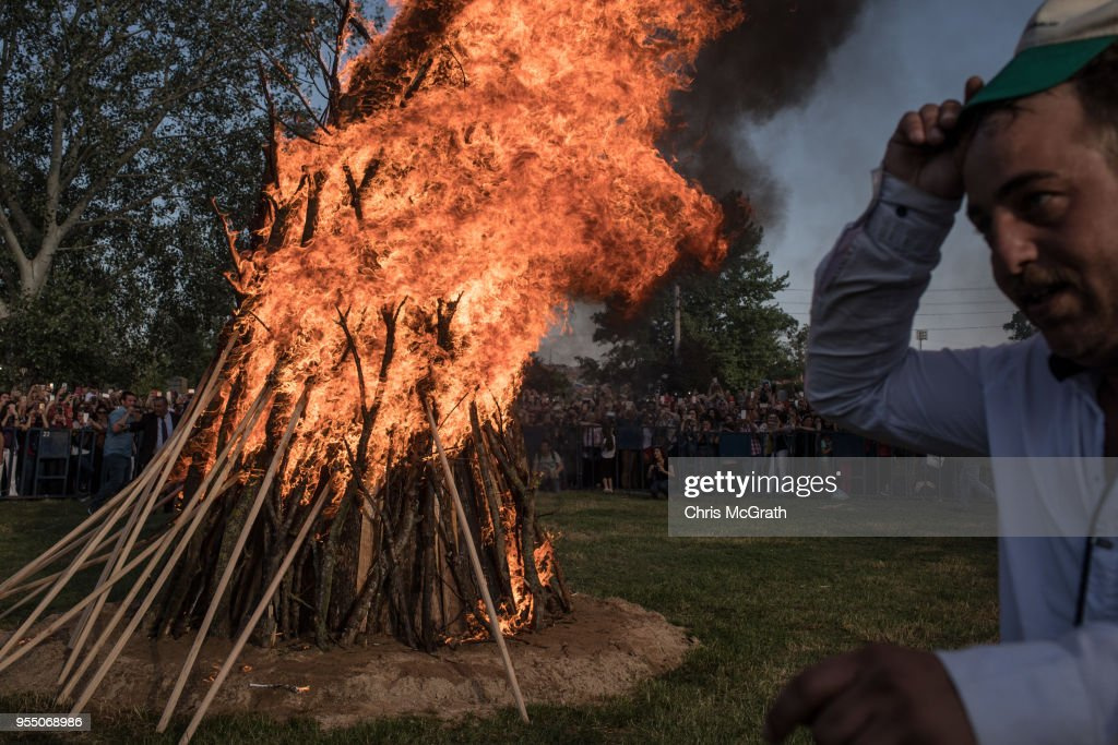 A man runs past a large bonfire after it is lit during the Kakava Festival on May 5, 2018 in Edirne, Turkey. The annual Kakava (Hõdõrellez) spring festival celebrates the coming of spring amongst the Roma community.
