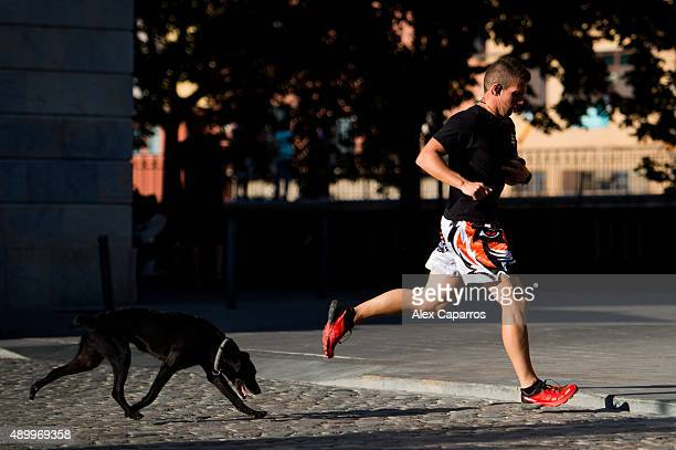 Man runs with his dog on September 24, 2015 in Girona, Spain. Over 5 million Catalans will be voting in Parliamentary elections on September 27, with...