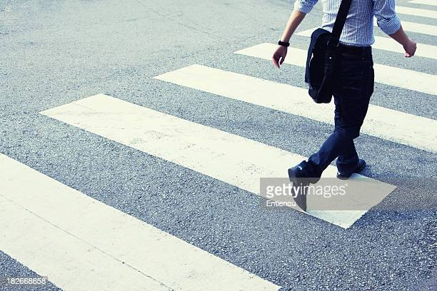 Man rushing across zebra crossing