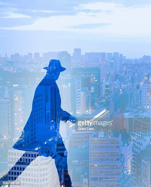 man rushing over tokyo skyline - privateinvestigator stock pictures, royalty-free photos & images