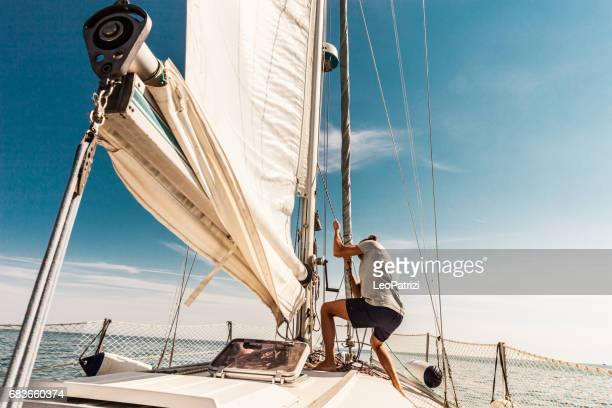 man sailing and fishing during summer holidays - sailor stock pictures, royalty-free photos & images