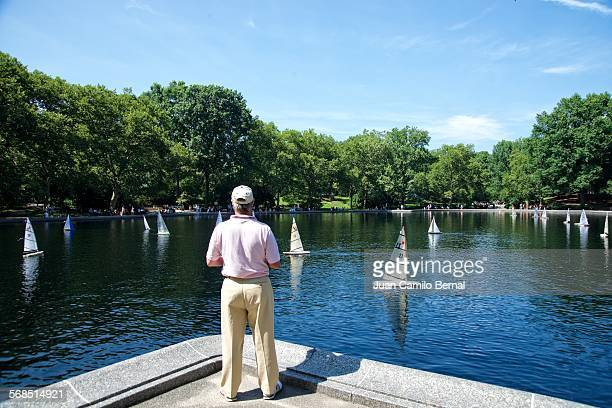 Man sailing boats in Central Park