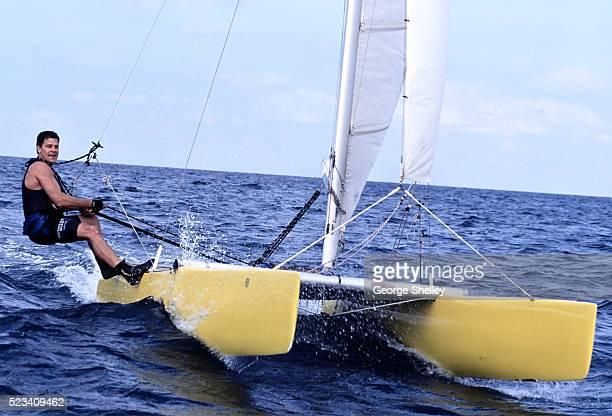 Man Sailing Catamaran