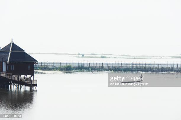 man sailing in lake against clear sky - ko ko htike aung stock pictures, royalty-free photos & images