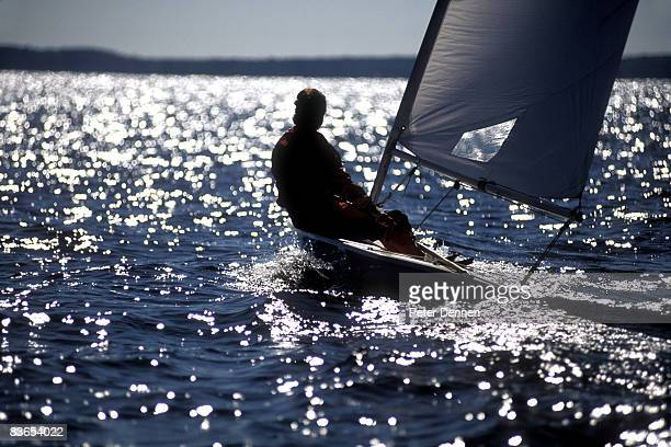 Man sailing on a lake.