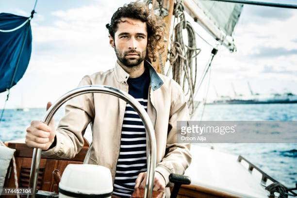 man sailing - team captain stock pictures, royalty-free photos & images