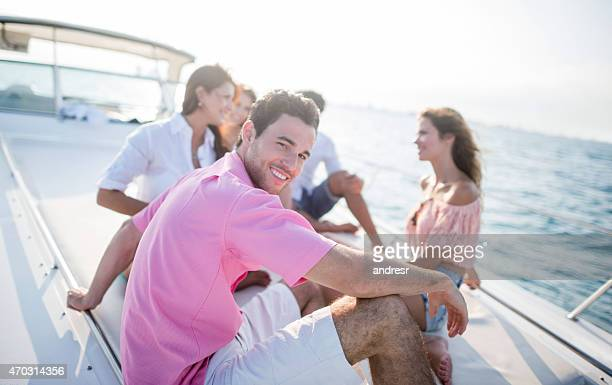 Man sailing with a group of friends