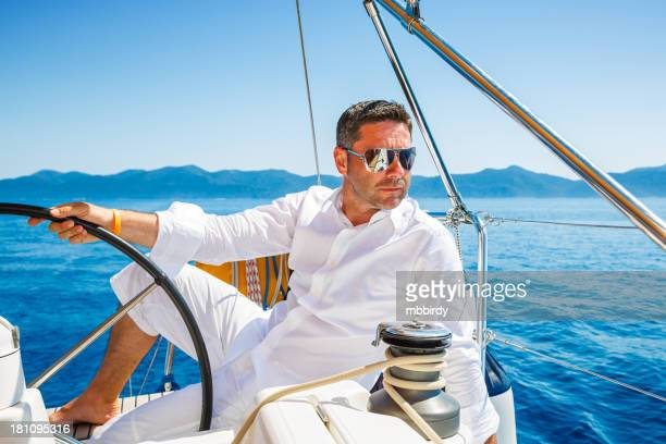 Man sailing with sailboat