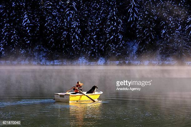A man sails as snows cover at KaragolSahara National Park which contains the Savsat and Borcka lakes in Artvin Turkey on November 9 2016