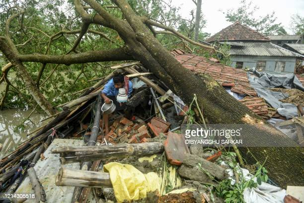A man salvages items from his house damaged by cyclone Amphan in Midnapore West Bengal on May 21 2020 At least 22 people died as the fiercest cyclone...