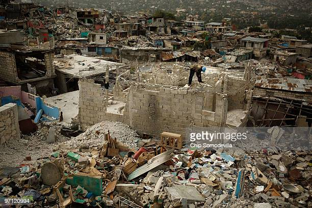 Man salvages steel rebar from the shattered roof of a destroyed home in the Fort National neighborhood February 26, 2010 in Port-au-Prince, Haiti....