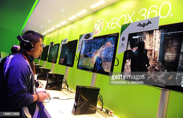 A man samples games on the XBOX 360 at the International Consumer Electronics Show in Las Vegas Nevada on January 11 2012 A dazzling array of...