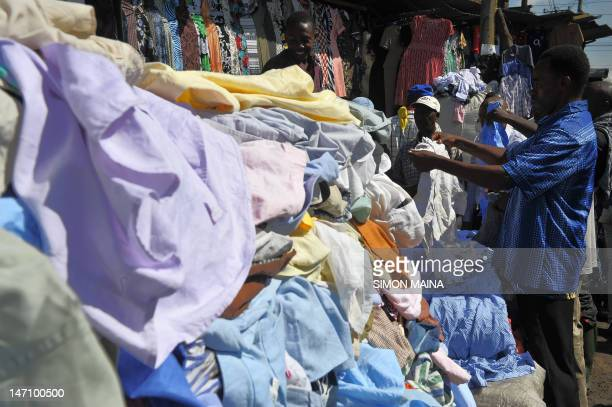 A man samples secondhand clothes at the Gikomba openair market on June 25 in Nairobi Local dealers welcomed Kenya's Finance minister Njeru Githai's...