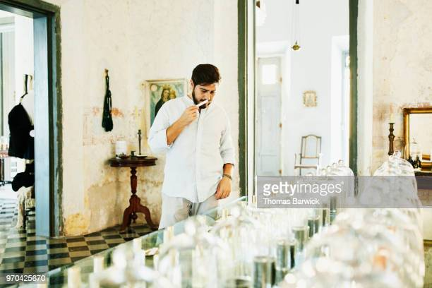 Man sampling fragrances in perfumery