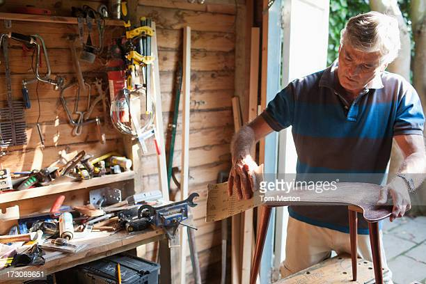man sanding wood in workshop - shed stock pictures, royalty-free photos & images