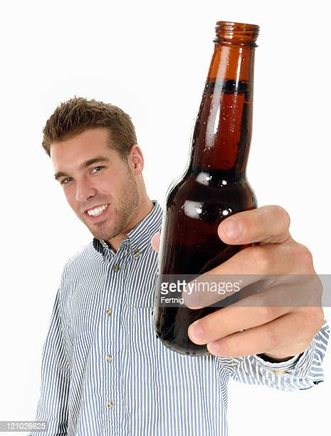 Man saying cheers or skol with a beer
