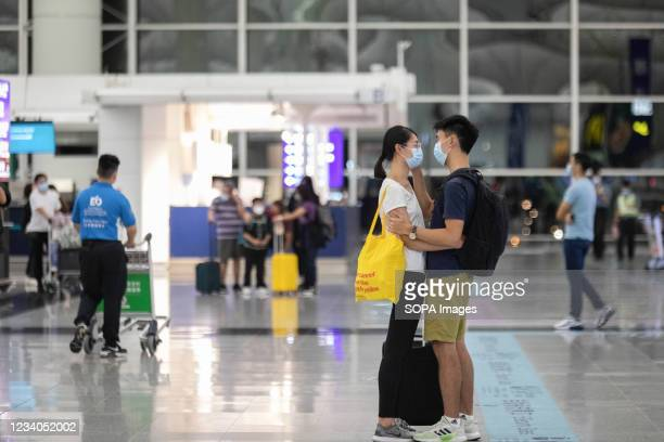 """Man says farewell to his girlfriend before departure, at Hong Kong international airport a day before the deadline of """"Leave outside the Rules"""" for..."""