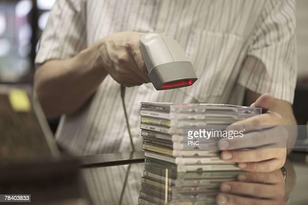 Man scanning cds