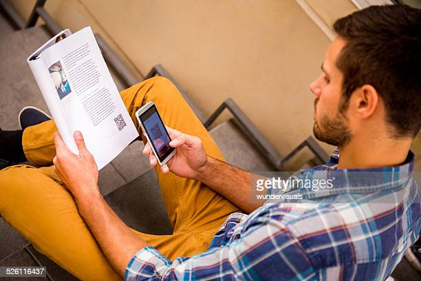 Man Scanning QR Code With Smartphone