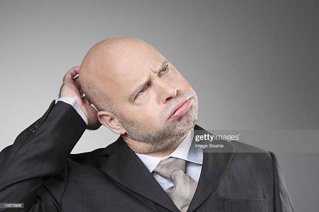 Man scratching his head : Stock Photo