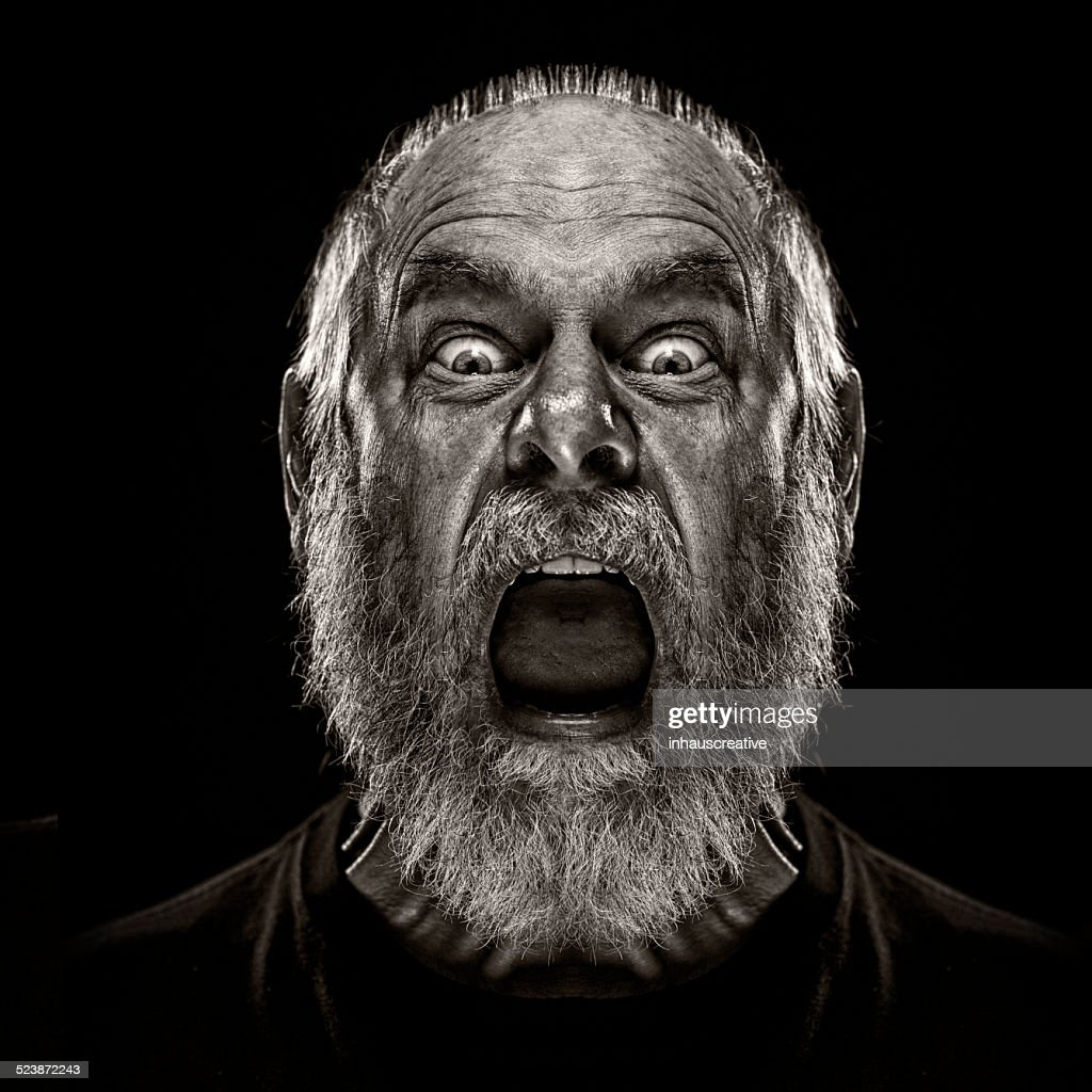 Man Screaming and looking terrified : Stock Photo