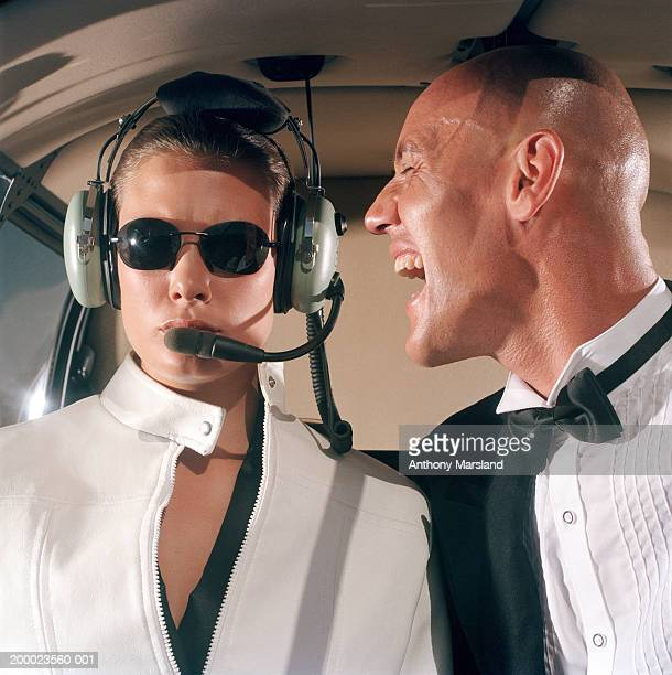 Man screaming at female helicopter pilot, close-up