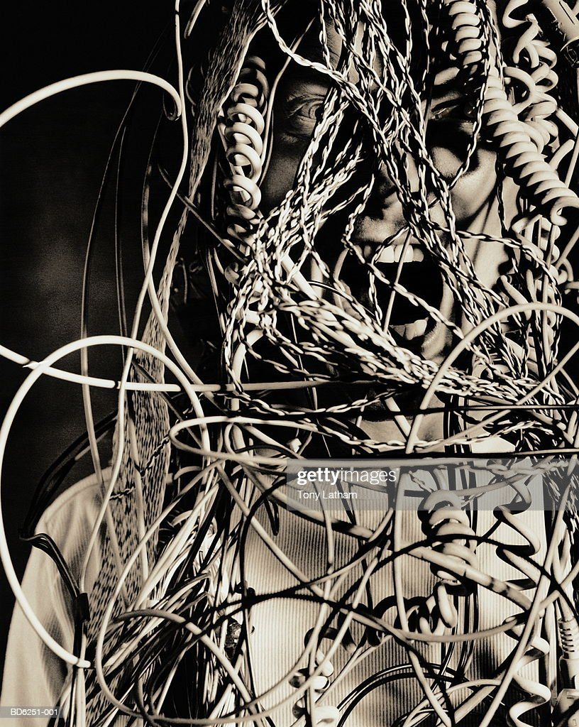 Man Screaming Behind Bunch Of Tangled Wires Stock Photo | Getty Images