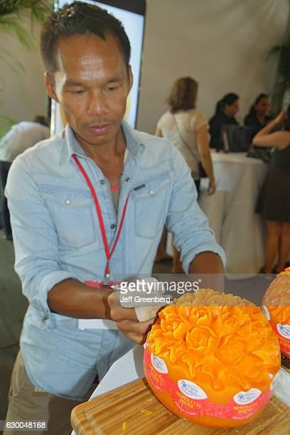 A man sculpting Mimolette cheese at Art Miami