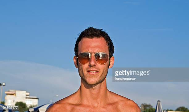 man sea the sky with sunglasses