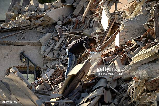 Man searches among damaged buildings after a strong earthquake hit central Italy, in Amatrice on August 24, 2016. A powerful 6.2-magnitude earthquake...