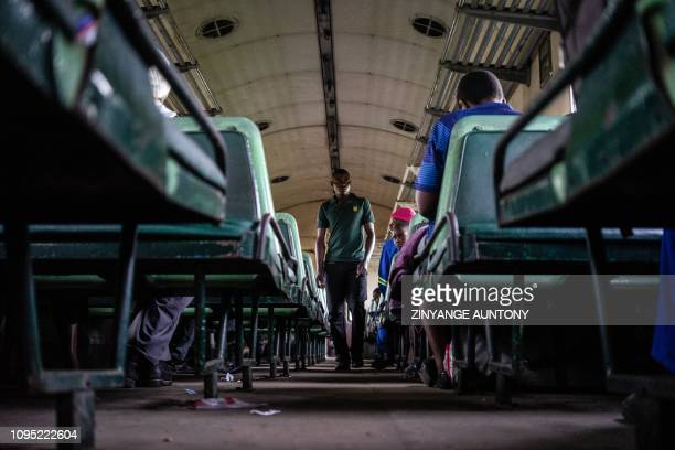 Man searches for a vacant seat onboard a commuter train on January 29, 2019 in Cowdray Park township, in Bulawayo Zimbabwe. - Zimbabwe's only...