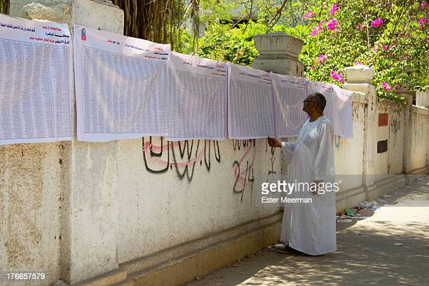 Man searches for his name on the lists of people eligible to vote, outside a polling station in Cairo, on the day of the second round of the Egyptian...
