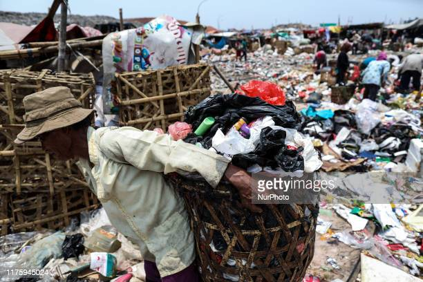 A man searches for items and plastics to sell for recycling at Rawa Kucing landfill in Tangerang Banten province Indonesia on 14 October 2019...