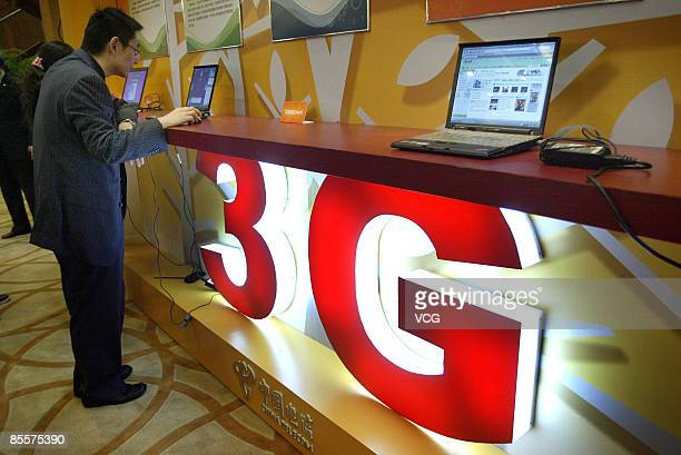 A man searches the internet using 3G technology at a China telecom 3G commercial use launch event on March 23 2009 in Nanjing Jiangsu Province China...