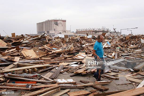 A man searches through debris left along Seawall Blvd by Hurricane Ike September 13 2008 in Galveston Texas Ike made landfall near Galveston early...