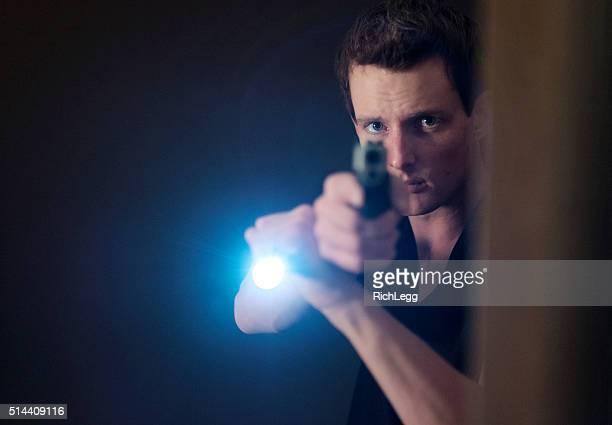 Man Searching a Dark Room