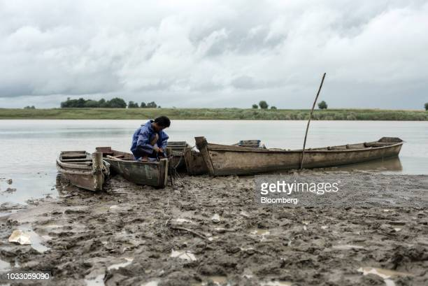A man secures his boats on the bank of the Cagayan River ahead of Typhoon Mangkhut's arrival in Tuguegarao Cagayan province the Philippines on Friday...