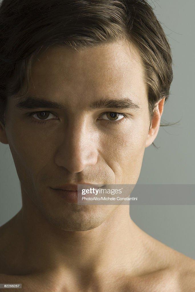 Man seductively looking at camera, close-up, portrait : Stock Photo