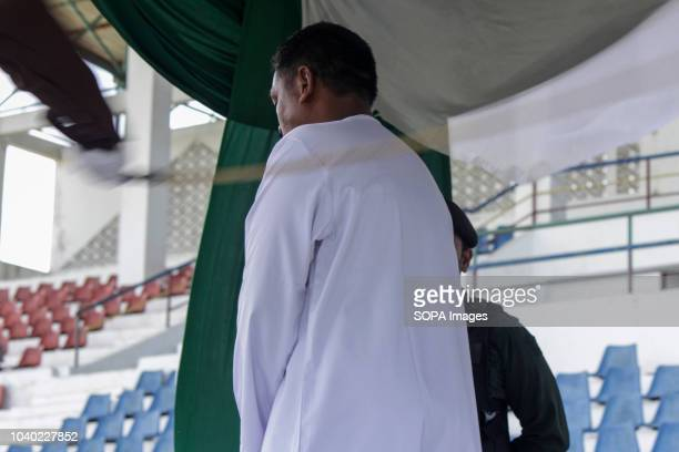 LHOKSEUMAWE ACEH INDONESIA A man seen being whipped in public for gambling which is considered to violate Islamic Sharia law Although considered to...