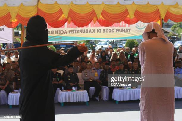 A man seen being whipped on the public stage 19 people were sentenced by the Meulaboh Sharia Court to being whipped in public for sexually abusing...