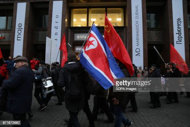 MOSCOW RUSSIA A man seen carring a North Korean flag Thousands marched to Revolution Square in central Moscow to commemorate the 100th anniversary of...