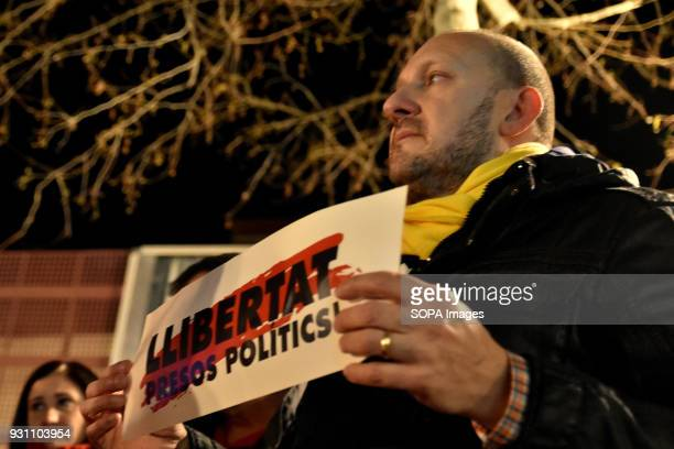 A man seen carrying a placard with the slogan freedom political prisoners during the protest Hundreds of people gathered in L'Hospitalet in support...