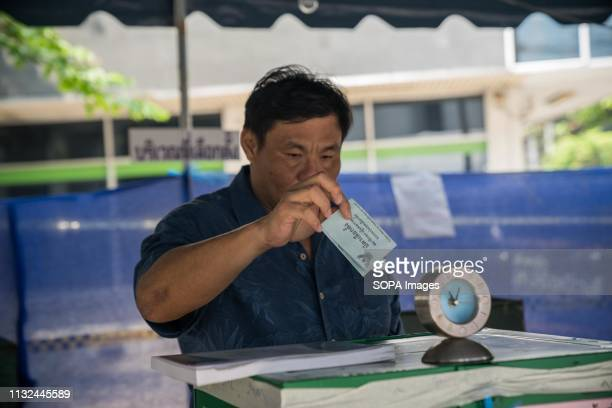 A man seen casting his ballot at a polling station Thailand is hosting its first General Election in 8 years Polling stations opens from 8am until 5pm