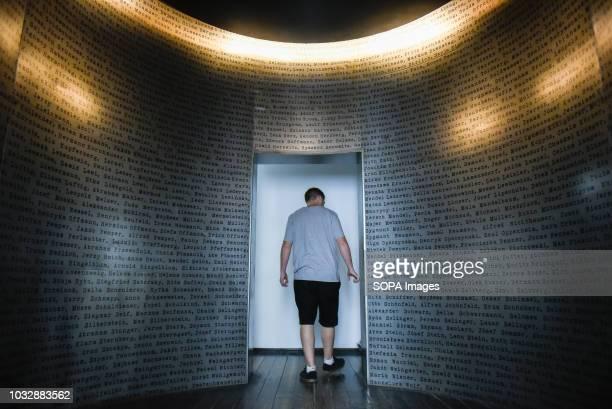 Man seen exiting Oskar Schindler list installation during the exhibition. Exhibition at Oskar Schindler's Enamel Factory museum, it is primarily a...