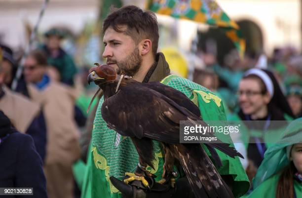 A man seen holding a falcon seen taking part in the Epiphany procession also know as Three Kings Day The Catholic feast day remembered the visit of...