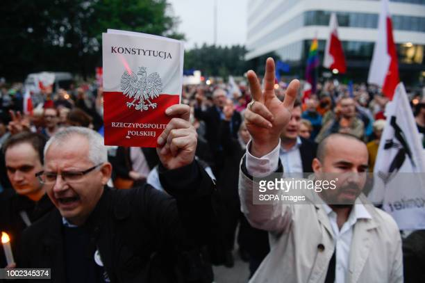 A man seen holding a polish constitution during the protest People demonstrate against reforms of the Supreme Court and demand for free courts in...
